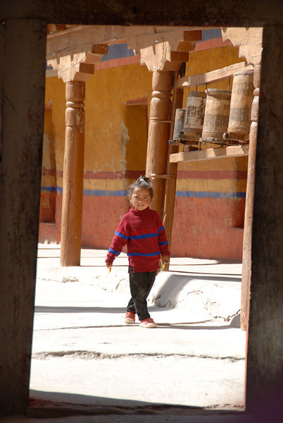 Young girl strolling the grounds of Likir Monastery in Ladakh