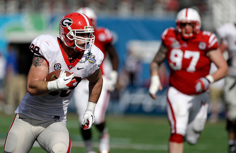 . Georgia tight end Arthur Lynch, left, runs for a 29-yard touchdown on a pass play past Nebraska defensive tackle Chase Rome (97) during the first half of the Capital One Bowl NCAA football game, Tuesday, Jan. 1, 2013, in Orlando, Fla. (AP Photo/John Raoux)
