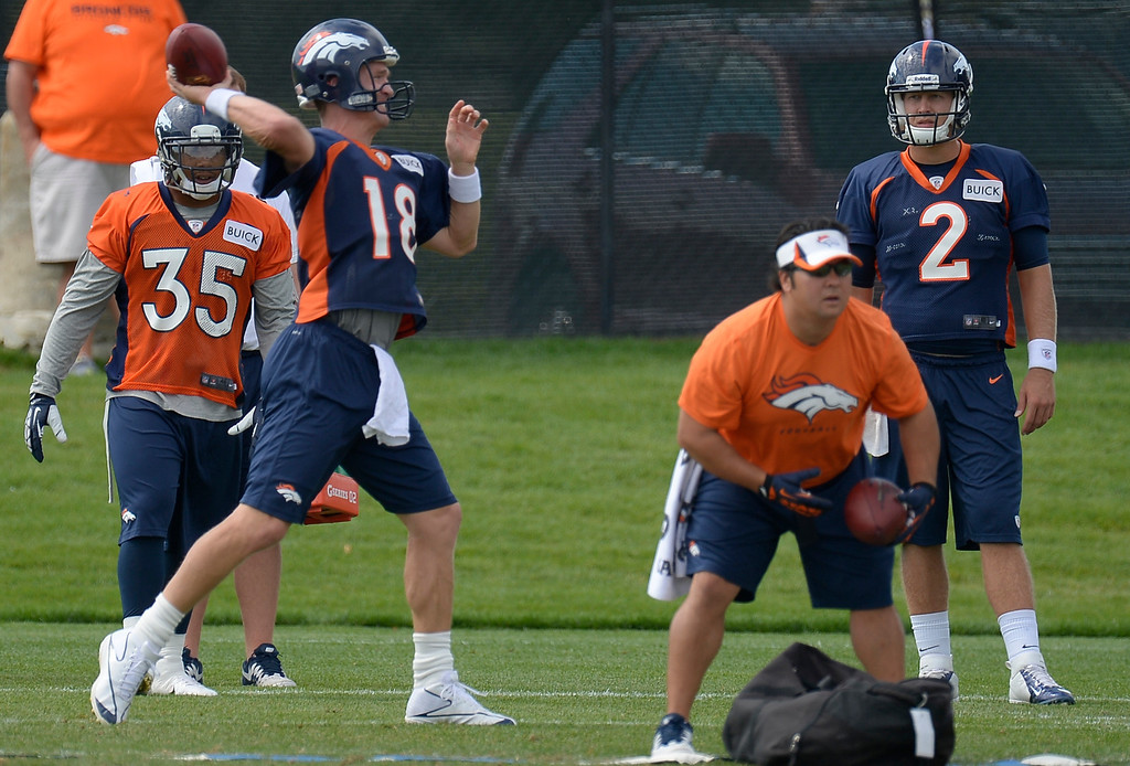 . Denver Broncos quarterback Peyton Manning (18) throws a pass during practice August 23, 2013 at Dove Valley (Photo by John Leyba/The Denver Post)