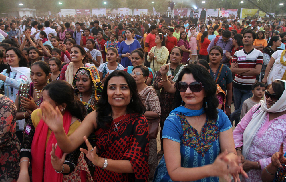 """Description of . Indian women dance in an event to support the \""""One Billion Rising\"""" global campaign in Ahmadabad, India, Thursday, Feb. 14, 2013. Thousands of women and children in various cities in the country danced in the streets, in malls and other places to express support for the One Billion Rising movement, a worldwide call to end violence against women and girls. (AP Photo/Ajit Solanki)"""