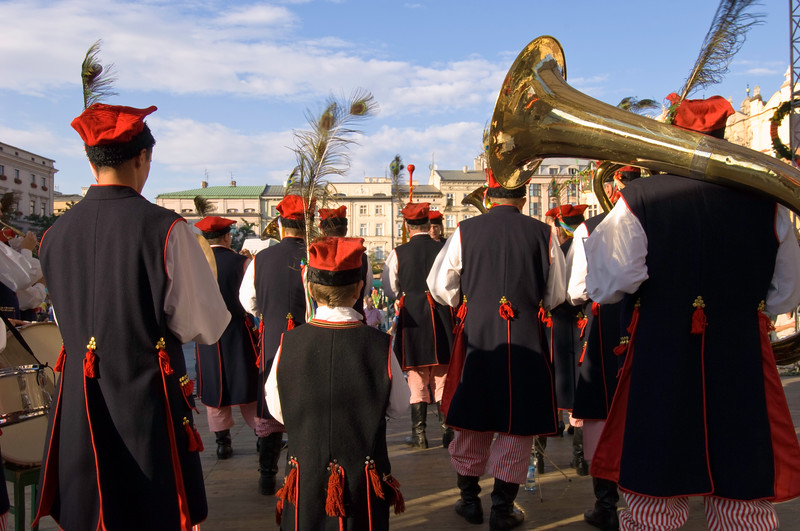 Poland, Cracow, brass band in Cracow style dress performing during folk festival