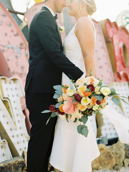 The Neon Museum - a colorful Las Vegas wedding venue //  Kristen Krehbiel - Kristen Kay Photography // Bouquet by Cultivate Goods // black tux and knee length gown #bouquet #colorful #classic