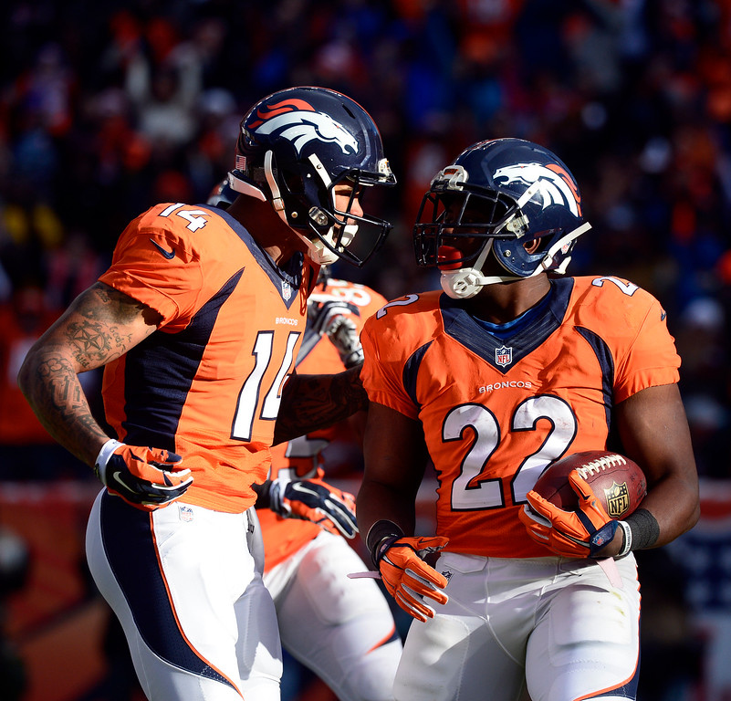 . DENVER, CO - DECEMBER 28: C.J. Anderson (22) of the Denver Broncos celebrates with Cody Latimer (14) of the Denver Broncos after scoring Denver\'s first touchdown of the game in the first quarter.  The Denver Broncos played the Oakland Raiders at Sports Authority Field at Mile High in Denver on December, 28 2014. (Photo by Tim Rasmussen/The Denver Post)