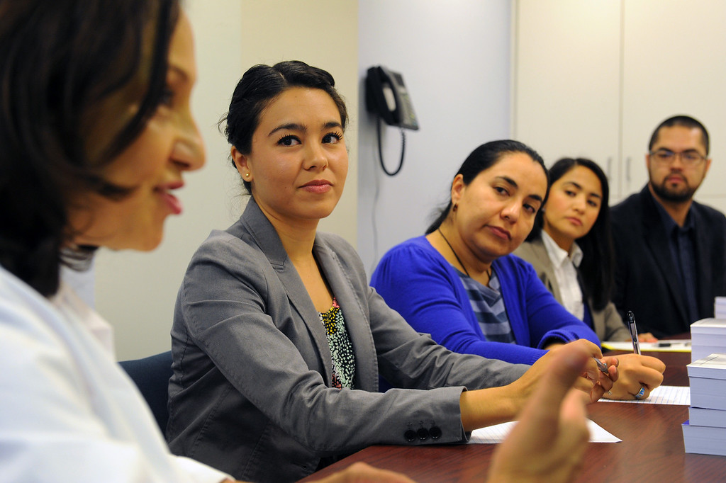 . Dr. Michelle Bholat, executive director for UCLA\'s International Medical Graduate Program, left, talks with a group of doctors from Latin American, Wednesday, April 16, 2014, at the UCLA Family Health Center. They are from left, Alanna Chig, Carla DeLeon, Aichel Nateras and Jorge Otañez. (Photo by Michael Owen Baker/L.A. Daily News)
