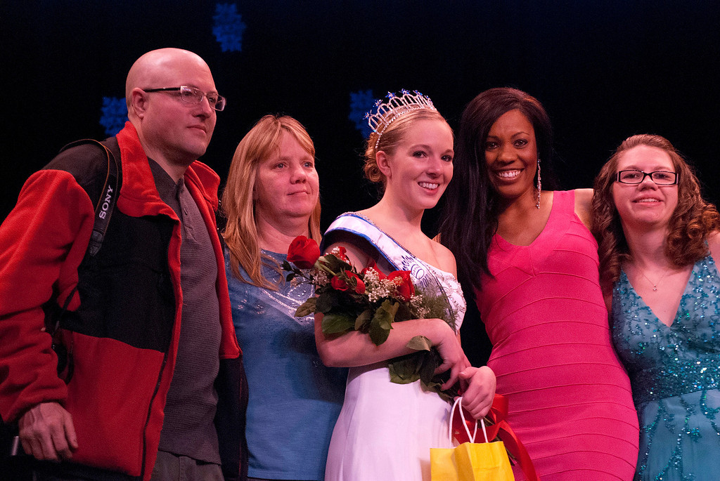 . Kayla Rice/Reformer 2013 Winter Carnival Queen Alison Cornellier stands with her parents and pageant directors before preparing to pass on the crown during the 2014 Brattleboro Winter Carnival Queen\'s Pageant on Friday evening.