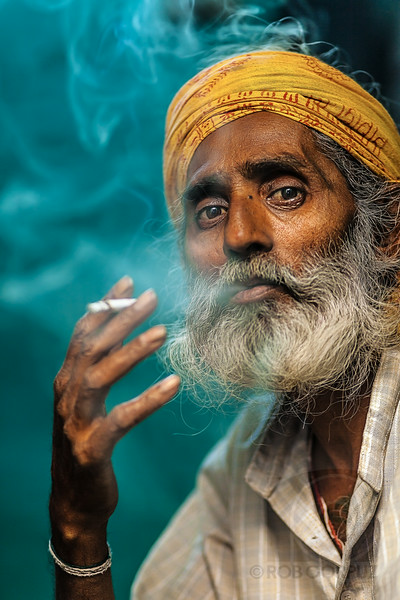 SMOKING MAN - New Delhi, India  To read the story behind this photo (as well as about Yousuf Karsh's iconic portrait of Winston Churchill), go to my blog post here or just check out my blog.  To see more photos I took in India, click here.