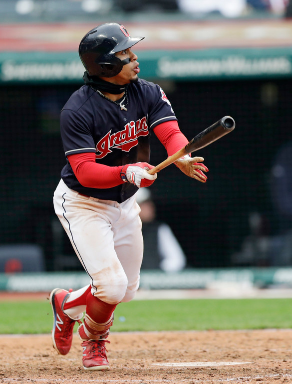 . Cleveland Indians\' Francisco Lindor watches his solo home run off Kansas City Royals Kevin McCarthy during the seventh inning of a baseball game Saturday, May 12, 2018, in Cleveland. The Indians won 6-2. (AP Photo/Tony Dejak)