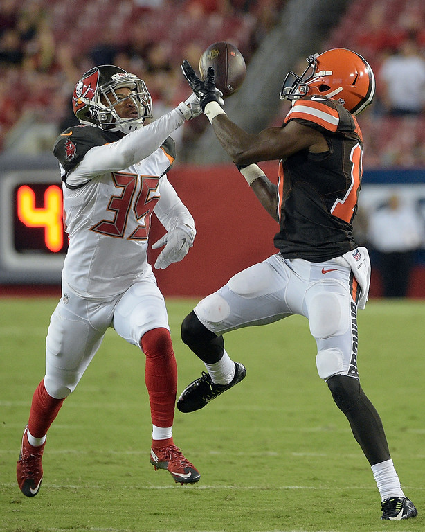 . Tampa Bay Buccaneers defensive back Javien Elliott (35) knocks away a pass intended for Cleveland Browns wide receiver Darius Jennings (17) during the fourth quarter of an NFL preseason football game Friday, Aug. 26, 2016, in Tampa, Fla. (AP Photo/Phelan M. Ebenhack)