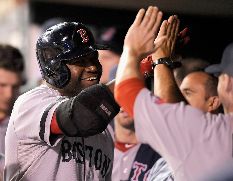 . David Ortiz celebrates a two-run home run against the Minnesota Twins during the seventh inning. (Photo by Hannah Foslien/Getty Images)