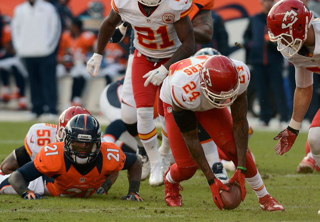 . Kansas City Chiefs cornerback Brandon Flowers (24) recovers a fumble by Denver Broncos running back Ronnie Hillman (21) as the Denver Broncos took on the Kansas City Chiefs at Sports Authority Field at Mile High in Denver, Colorado on December 30, 2012. John Leyba, The Denver Post
