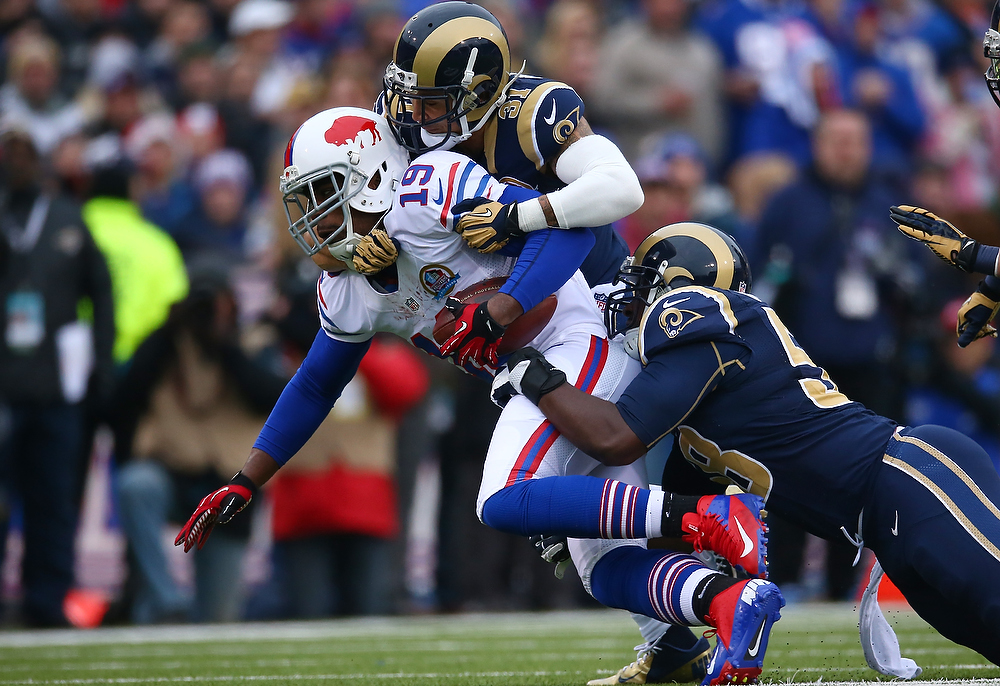 . Donald Jones #19 of the Buffalo Bills is tackled during an NFL game by Cortland Finnegan #31 of the St. Louis Rams at Ralph Wilson Stadium on December 9, 2012 in Orchard Park, New York. (Photo by Tom Szczerbowski/Getty Images)