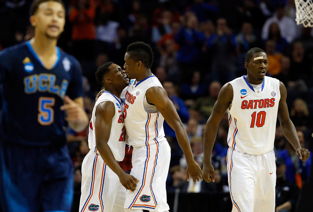 . Michael Frazier II #20 and Will Yeguete #15 of the Florida Gators celebrate against the UCLA Bruins during a regional semifinal of the 2014 NCAA Men\'s Basketball Tournament at the FedExForum on March 27, 2014 in Memphis, Tennessee.  (Photo by Kevin C. Cox/Getty Images)