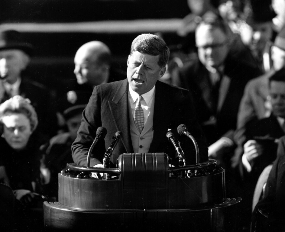 ". U.S. President John F. Kennedy delivers his inaugural address after taking the oath of office at Capitol Hill in Washington, D.C. on Jan. 20, 1961. Kennedy said, ""We shall pay any price, bear any burden, meet any hardship, support any friend, oppose any foe, to assure the survival and success of liberty.\"" Kennedy was sworn in as the 35th president of the United States. (AP Photo)"