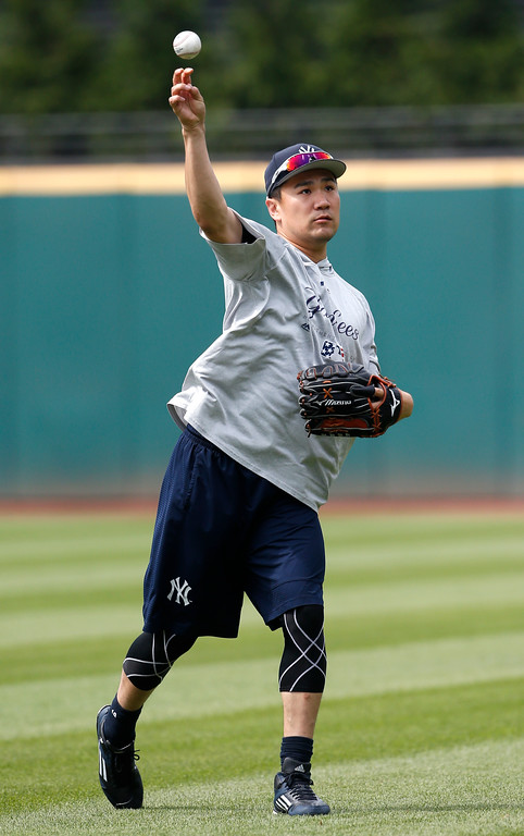 . New York Yankees\' Masahiro Tanaka warms up before a baseball game against the Cleveland Indians, Saturday, July 14, 2018, in Cleveland. (AP Photo/Ron Schwane)