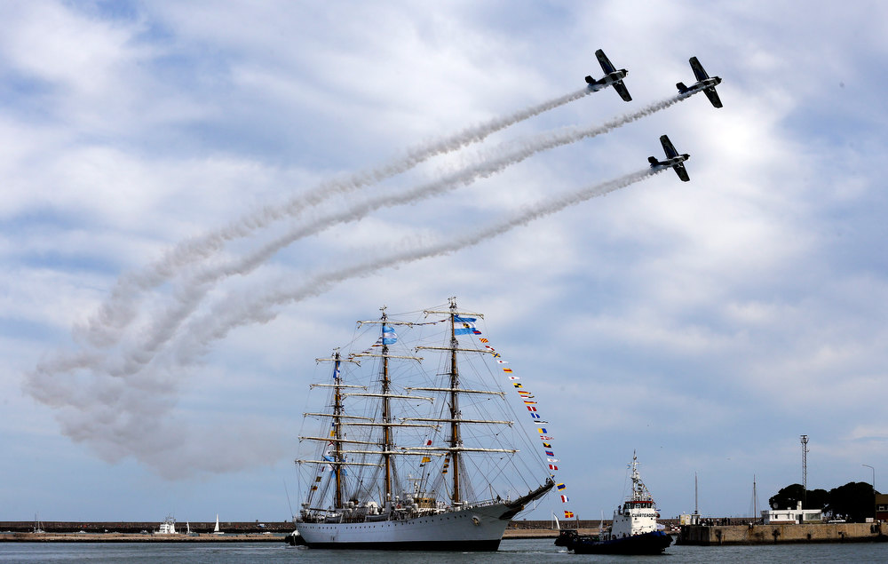 Description of . Argentina's naval training tall ship ARA Libertad arrives to port as planes fly overhead during a ceremony in Mar del Plata, Argentina, Wednesday, Jan. 9, 2013. The Argentine naval ship detained for more than two months in Ghana because of a financial dispute returned home to a triumphant welcome. Ghana courts ordered the ship held in October on a claim by Cayman Islands-based hedge fund NML Capital Ltd. But the U.N.'s International Tribunal for the Law of the Sea ordered the ship's release last month after Argentina argued that warships are immune from seizure. (AP Photo/Natacha Pisarenko)