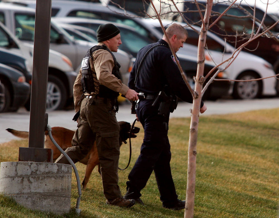 . A Natrona County Sheriff\'s canine handler arrives at the scene of a reported homicide at Casper College on Friday morning, Nov. 30, 2012, in Casper, Wyo. At least one person was killed and another was wounded Friday in an attack at Casper College, a community college in central Wyoming. It happened around 9 a.m., said school spokesman Rich Fujita.  (AP Photo/Casper Star-Tribune, Alan Rogers) TRIB.COM