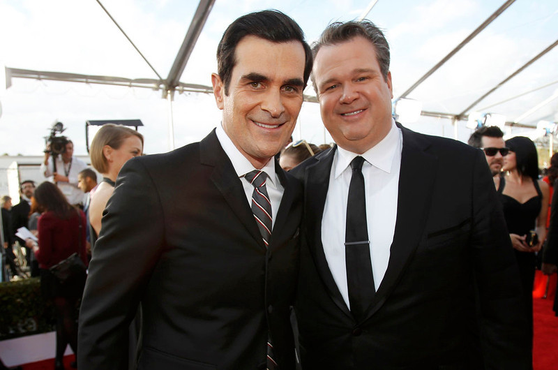 . Ty Burrell (L) and Eric Stonestreet arrive at the 19th annual Screen Actors Guild Awards in Los Angeles, California January 27, 2013.  REUTERS/Mario Anzuoni