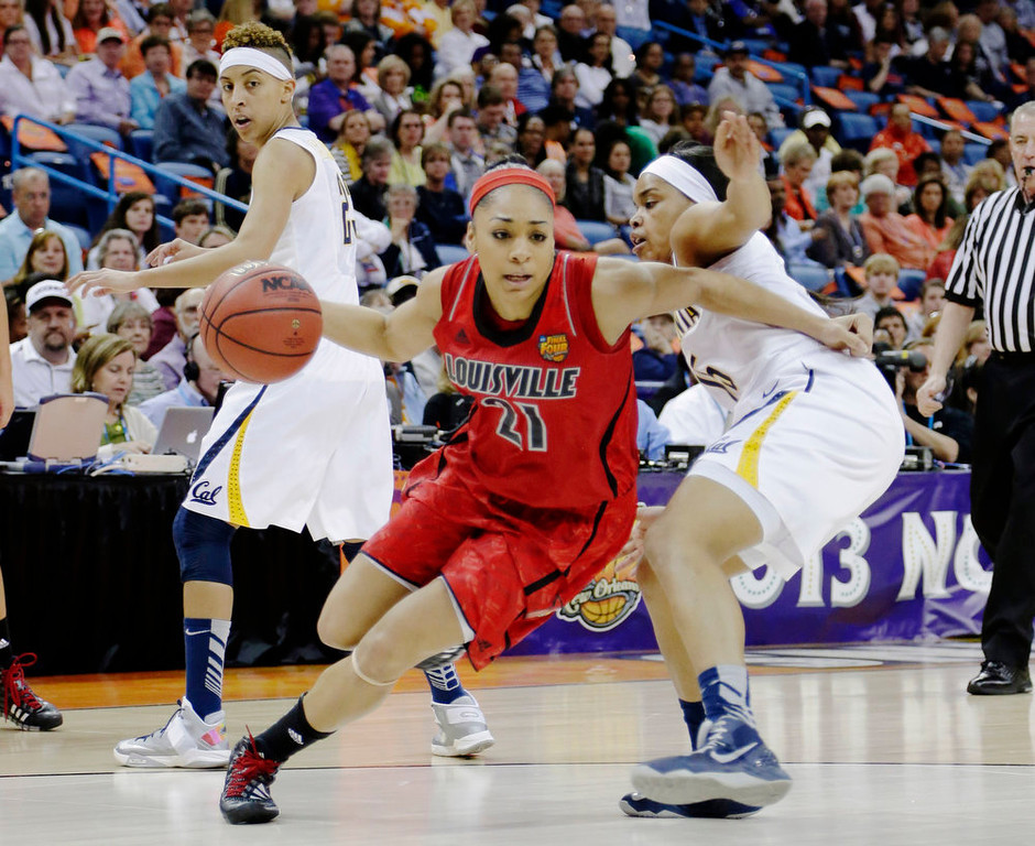 . Louisville guard Bria Smith (21) drives the ball against California guard Brittany Boyd (15) in the first half of a national semifinal at the Women\'s Final Four of the NCAA college basketball tournament, Sunday, April 7, 2013, in New Orleans. (AP Photo/Gerald Herbert)