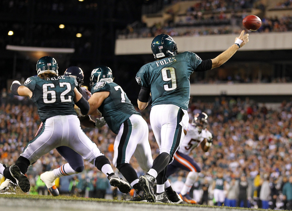 . PHILADELPHIA, PA - DECEMBER 22: Quarterback Nick Foles #9 of the Philadelphia Eagles attempts a pass against the Chicago Bears in the second half during a game at Lincoln Financial Field on December 22, 2013 in Philadelphia, Pennsylvania. The Eagles defeated the Bears 54-11. (Photo by Rich Schultz /Getty Images)