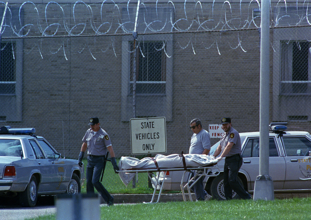 . The body of the sixth prisoner killed at a riot at the Southern Ohio Correctional Facility in Lucasville, Ohio, is removed, April 12, 1993. Inmates rioted yesterday, taking guards hostage and killing other inmates. (AP Photo/David Kohl)