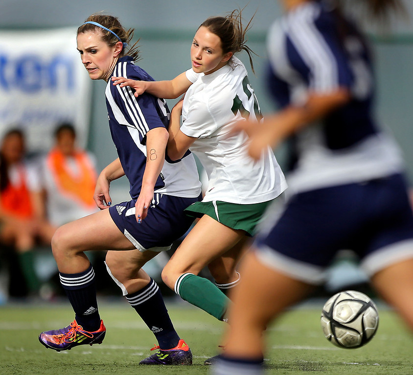 . Harbor High freshman Mollie Brown keeps an eye on the ball as she shoves away TKA\'s Kylie von Ritcher during the first half of the CCS Division III girls soccer match at Valley Christian High in San Jose on Saturday. (Kevin Johnson/Sentinel)