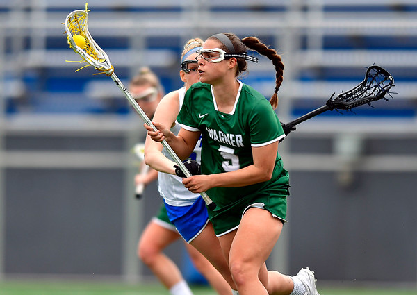 4/20/2019 Mike Orazzi | Staff Wagner Women's Lacrosse's Maddie Courtney (5) in New Britain on Saturday.