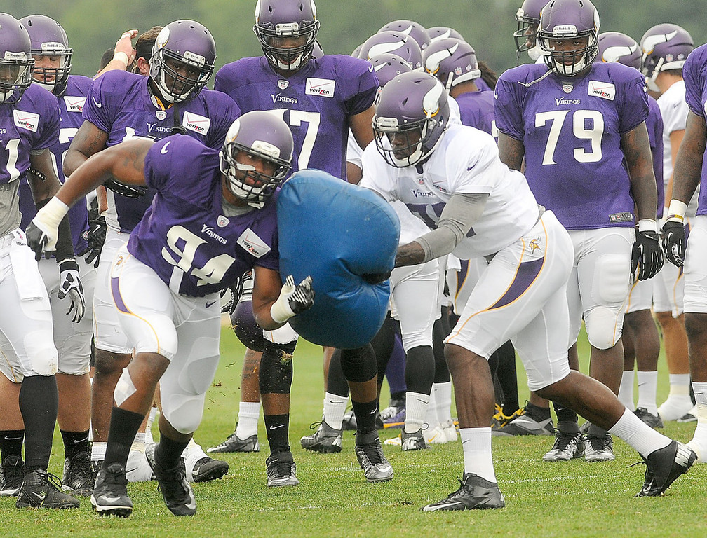 . Vikings tight end LaMark Brown, right, blocks defensive end Lawrence Jackson during drills. (Pioneer Press: Sherri LaRose-Chiglo)