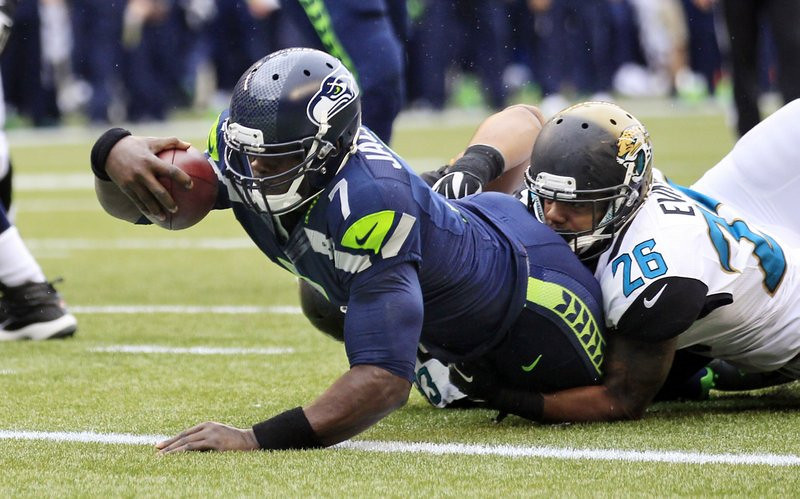 . <p><b> Seahawks at Texans (+3):</b>  <p>Former Viking Tarvaris Jackson came off the bench Sunday to throw for one touchdown and run for another against lowly Jacksonville, tying the NFL record for most acorns found by a blind squirrel. <p>Pick: <b>Seahawks by 7</b> <p>    (AP Photo/Stephen Brashear)