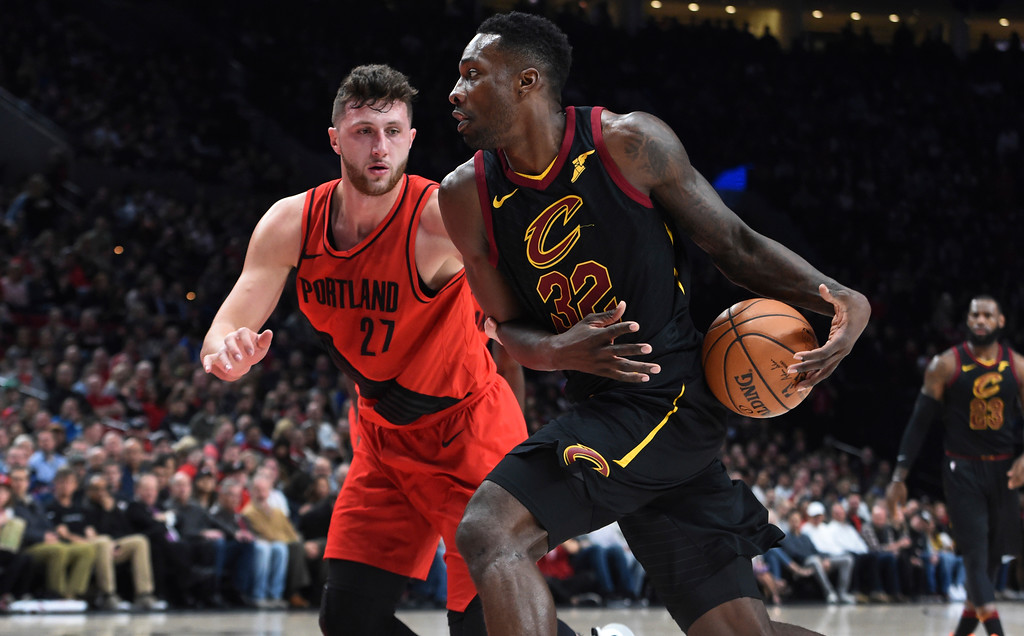 . Cleveland Cavaliers forward Jeff Green, right, drives to the basket on Portland Trail Blazers center Jusuf Nurkic, left, during the first half of an NBA basketball game in Portland, Ore., Thursday, March 15, 2018. (AP Photo/Steve Dykes)