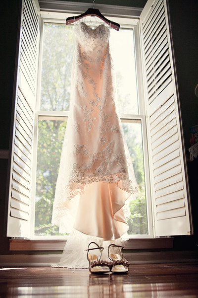 wedding dress in front of window