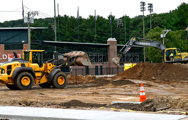 9/10/2019 Mike Orazzi | StaffrBristol Public Works employes while working on a expanded parking lot next to Muzzy Field. According to Mayor Ellen Zoppo-Sassu, The budget cost for doing it in-house is $120,000. The estimated cost is performed by contractors is $270,000 so the city is realizing a $150,000 savings. The work is being performed by the Public Works Street division.This includes land clearing, grading, installation of storm drainage, paving curbing lighting, (not including electrical)electrical conduit and landscaping. The concrete sidewalks lighting electrical systems and pavement markings will be performed by outside contractors. The existing concrete sidewalk square signed by former Red Sox players Wade Boggs etc. is preserved and will remain. The landscaping will include 21 trees.