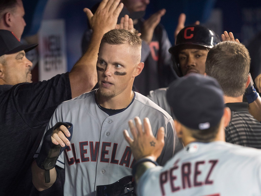 . Cleveland Indians\' Brandon Guyer celebrates after scoring on a Francisco Lindor single against the Toronto Blue Jays during the fifth inning of a baseball game Thursday, Sept. 6, 2018, in Toronto. (Fred Thornhill/The Canadian Press via AP)