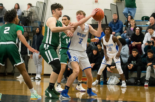 01/13/20 Wesley Bunnell | StaffrrBristol Eastern boys basketball hosted Maloney on Monday night January 13, 2019. Drew Fries (32) looks for room.