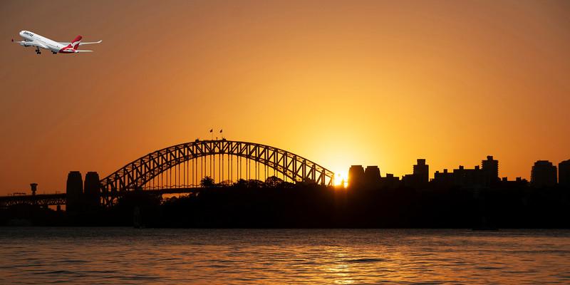 Aircraft in flight departing Sydney in an orange sunset sky.
