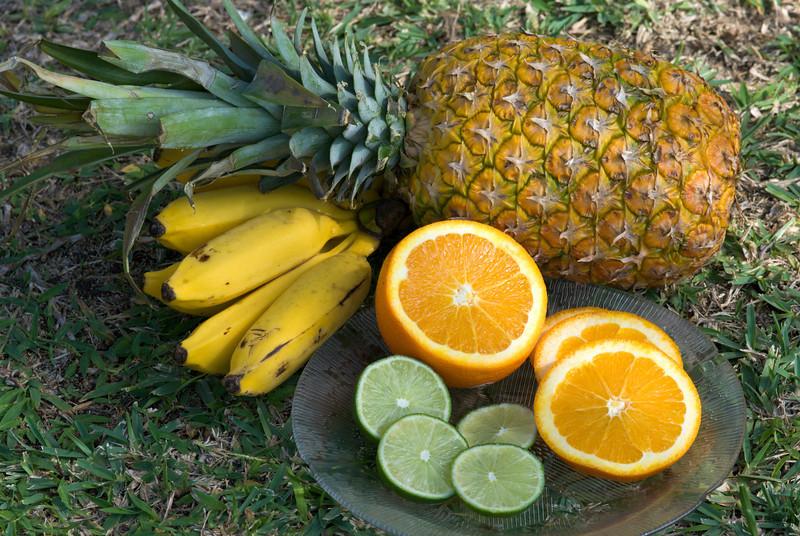 Fruits bananas, oranges, lime, pineapple
