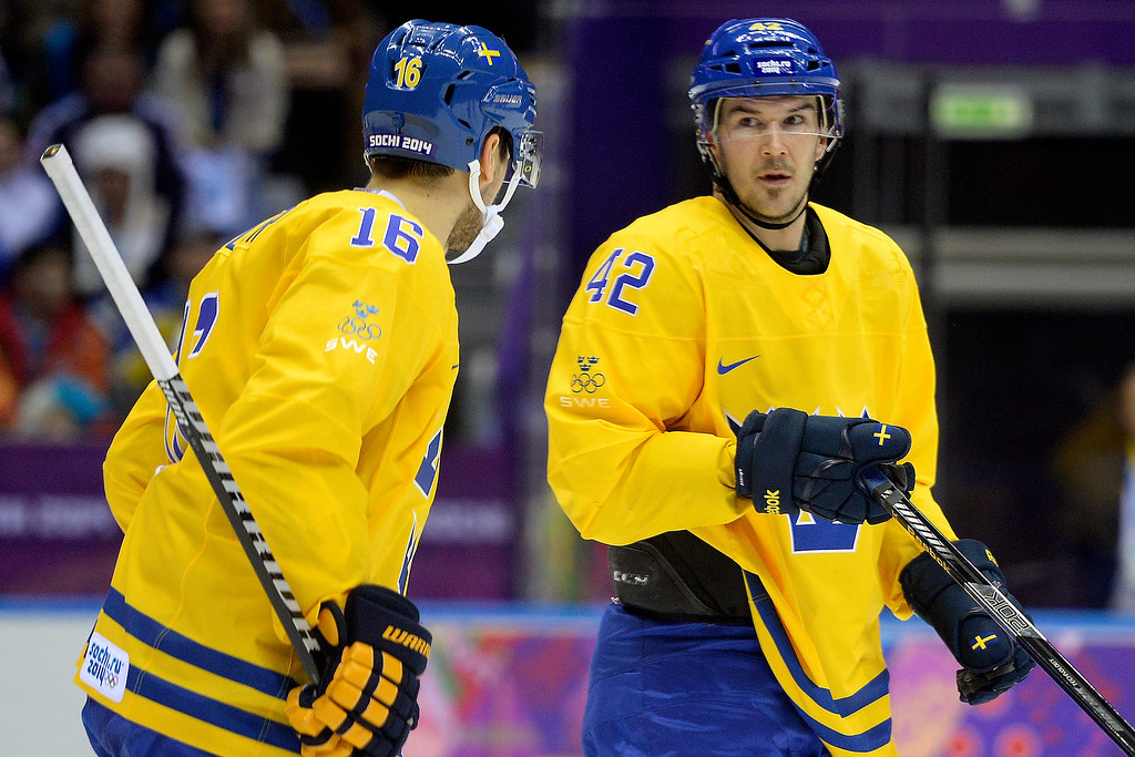 . Sweden players Marus Kruger (16) and Jimmie Ericsson chat during the action at Bolshoy Arena. Sochi 2014 Winter Olympics on Friday, February 14, 2014. (Photo by AAron Ontiveroz/The Denver Post)