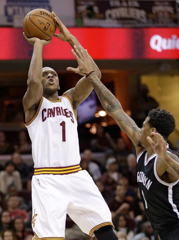. Cleveland Cavaliers\' James Jones, left, shoots over Brooklyn Nets\' Chris McCullough in the second half of an NBA basketball game, Friday, Dec. 23, 2016, in Cleveland. (AP Photo/Tony Dejak)