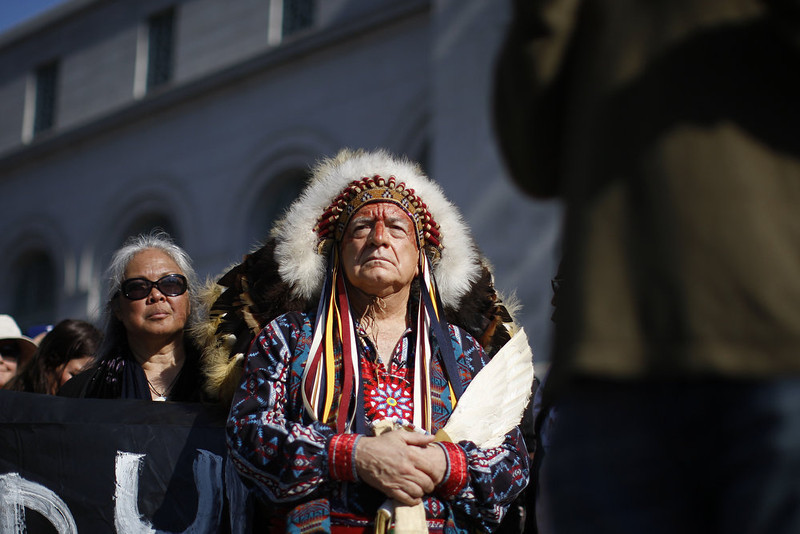 ". Chief Phil Lane of the Yankton Dakota and Chickasaw First Nations awaits his introduction to speak on the steps of City Hall during the ""Forward on Climate\"" rally to call on President Obama to take strong action on the climate crisis on February 17, 2013 in Los Angeles, California. Organizers say the rally, which is led by Tar Sands Action Southern California and Sierra Club, is composed of a coalition of over 90 groups and coincides with similar rallies in Washington D.C. and other U.S. cities.  (Photo by David McNew/Getty Images)"