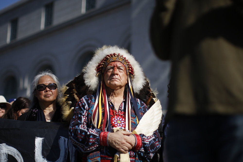 Description of . Chief Phil Lane of the Yankton Dakota and Chickasaw First Nations awaits his introduction to speak on the steps of City Hall during the