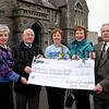 Cross Community Carols, Carols Together service hosted by Bessbrook Methodist Church in Bessbrook Town Hall raises £1,100.00 for Marie Curie Cancer Care.Pictured at the cheque presentation,l.tor.Carols Togeather sub-committee,Kathleen Moore,Mr Wesley Livingstone,Ms Sandra Spence from Marie Curie Cancer Care,Mrs Kathy Whiteside,Mr Samuel Cairns.R1302700