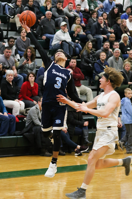 . 2018 - Basketball - Benedictine at Lake Catholic.  Benedictine defeated Lake Catholic 63-56.  Benedictine\'s Eric Buckner (3) catches a long pass.