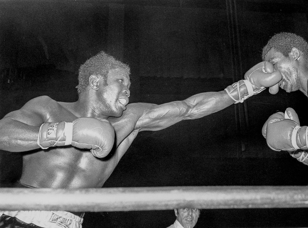 . San Francisco November 10, 1970 - Emile Griffith connects a left jab to Nate Collins\' left eye at the Cow Palace in the ninth round. (Howard Erker / Oakland Tribune)