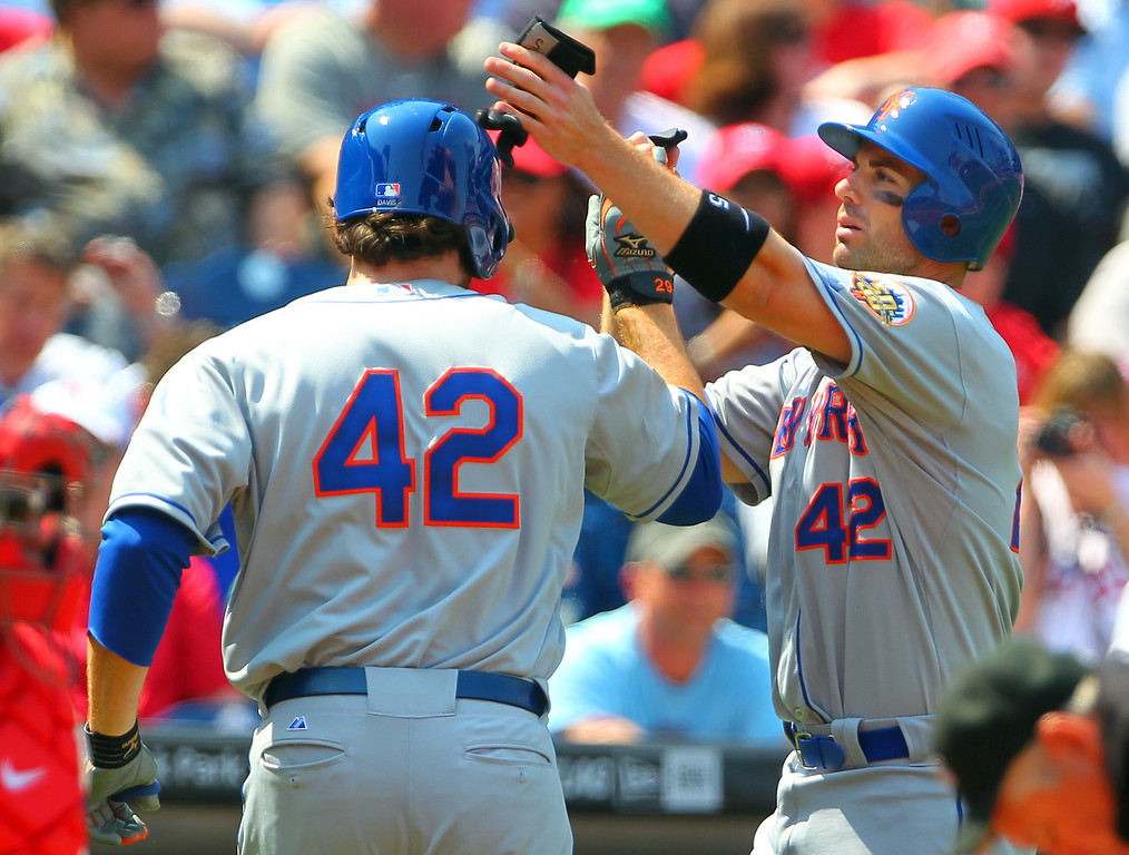 . Ike Davis (L) of the New York Mets is congratulated by teammate David Wright after Davis hit a two run-hommer against the Philadelphia Phillies in a MLB baseball game on April 15, 2012 at Citizens Bank Park in Philadelphia, Pennsylvania. To commemorate Jackie Robinson Day, all players and coaches will be wearing #42. (Photo by Rich Schultz/Getty Images)