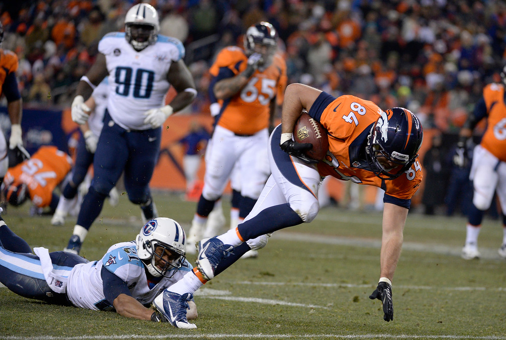 . Denver Broncos tight end Jacob Tamme (84) reaches out for extra yards during the second half after catching a pass from Denver Broncos quarterback Peyton Manning (18).  (Photo by Tim Rasmussen/The Denver Post)