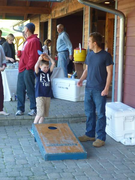 Aaron & Caleb playing corn hole