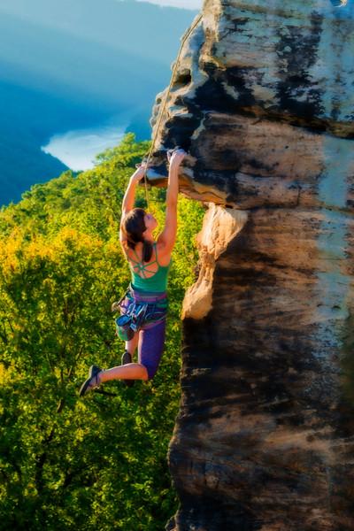Tara climbing the rock
