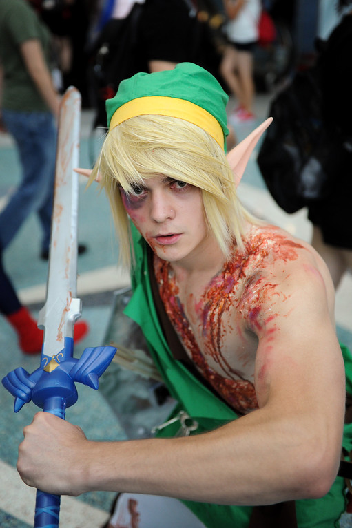 ". Noah Akumu, of Torrance, is dressed as the character ""Link\"" from the Legend of Zelda at the Anime Expo at the L.A. Convention Center, Saturday, July 6, 2013. (Michael Owen Baker/L.A. Daily News)"