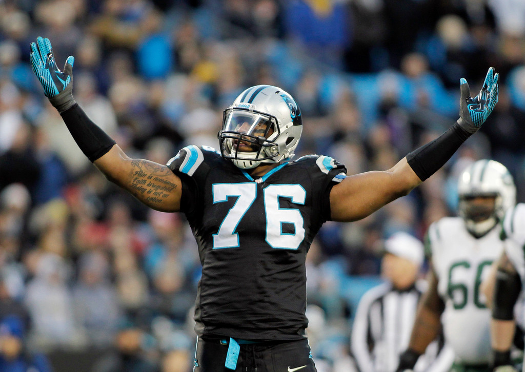 . Carolina Panthers\' Greg Hardy (76) celebrates after a sack against the New York Jets during the first half of an NFL football game in Charlotte, N.C., Sunday, Dec. 15, 2013. (AP Photo/Bob Leverone)