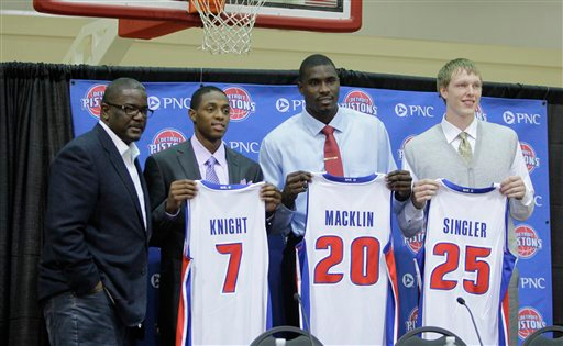 . Detroit Pistons team president of basketball operations Joe Dumars, far left stands with draft picks Brandon Knight, second from left, Vernon Macklin, center, and Kyle Singler at the team\'s practice facility in Auburn Hills, Mich., Saturday, June 25, 2011. (AP Photo/Carlos Osorio)
