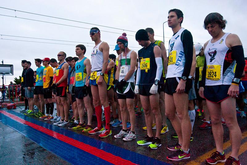 . Runners observe a moment of silence at the start of the Salt Lake City marathon at the University of Utah, Saturday, April 20, 2013, in Salt Lake City. (AP Photo/The Salt Lake Tribune, Chris Detrick)